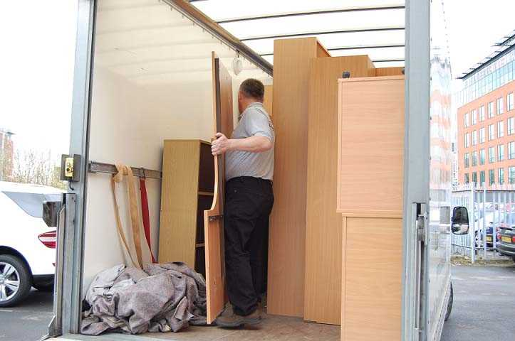 Loading the van with office furniture